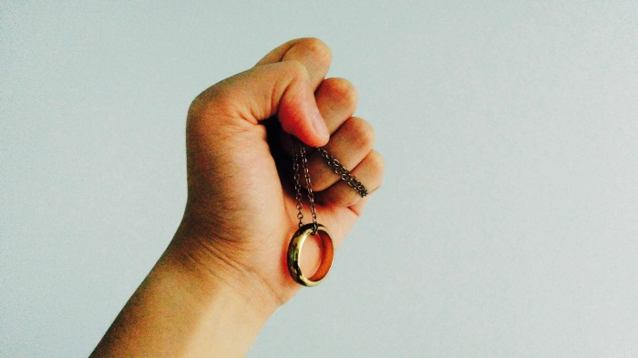 fist-holding-the-one-ring-necklace