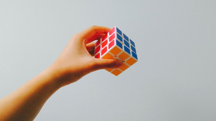 hand-holding-complete-rubik's-cube